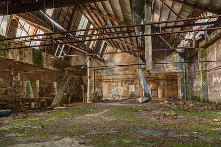 forsaken: old abandoned and collapsed factory with rubble and debris - ruins of an ancient industrial building