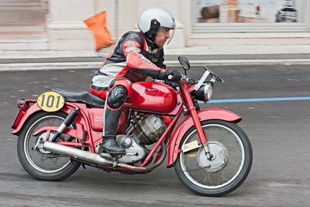 motosport: biker riding a vintage italian motorbike Moto Guzzi Lodola Gran Turismo at motorcycle rally Rombi di passione on september 30, 2012 in Lugo, RA, Italy
