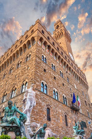 Italian landmark: a romanesque fortress palace Palazzo Vecchio, the town hall of Florence, Italy  and the ancient statue of Neptune photo