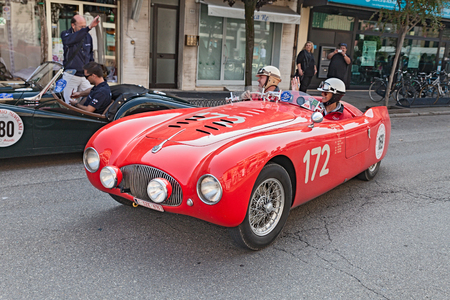 """the crew J. De Reu - S. Goethals on an old racing car Cisitalia 202 SMM Nuvolari Spider (1947) in historical rally for classic cars \\\""""Gran Premio Nuvolari\\\"""" on September 21, 2014 in Conselice, RA, Italy"""