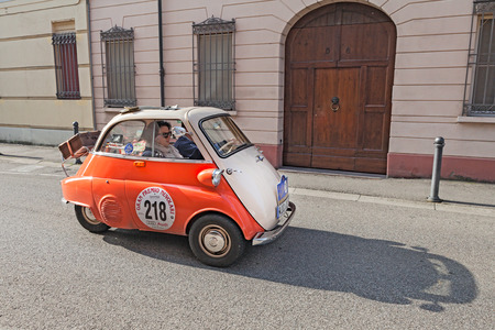 the crew Roland and Petra Hannak on a mini car BMW Isetta 300 Motocoupe\