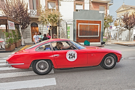 l first: the female crew F. Grimaldi - L. Ciaran on a vintage Lamborghini 350 GT (1965) in historical race Gran Premio Nuvolari on September 21, 2014 in Conselice, RA, Italy -  this car was the first production vehicle by Lamborghini. Editorial
