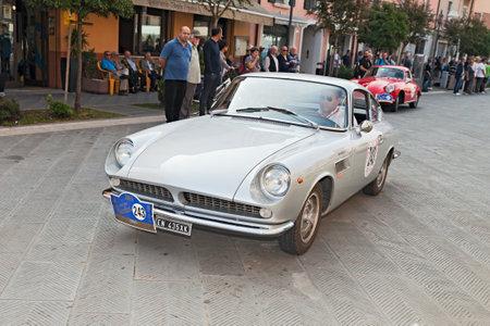 "the crew R. Roversi S. Miglioli on a vintage italian car ASA 1000 GT \\\\\\\""Ferrarina\\\\\\\"" (1964) designed by Ferrari, in historical race \\\\\\\""Gran Premio Nuvolari\\\\\\\"" on September 21, 2014 in Conselice, RA, Italy"
