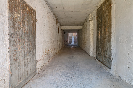 underpass in in the old italian town - narrow dark tunnel in ancient city of Italy photo