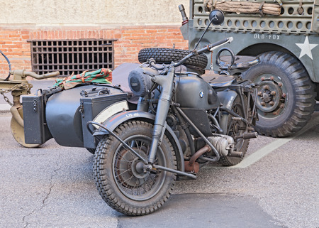 cc: old BMW R75 750 cc (1942), World War II-era German motorcycle with sidecar, at the military vehicle rally during the festival Fiera di San Rocco, on November 2, 2014 in Faenza, Italy