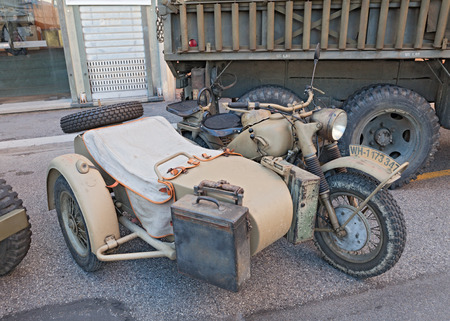old BMW R75 750 cc (1943), World War II era motorcycle with sidecar made in Germany, at the military vehicle rally during the festival Fiera di San Rocco, on November 2, 2014 in Faenza, Italy