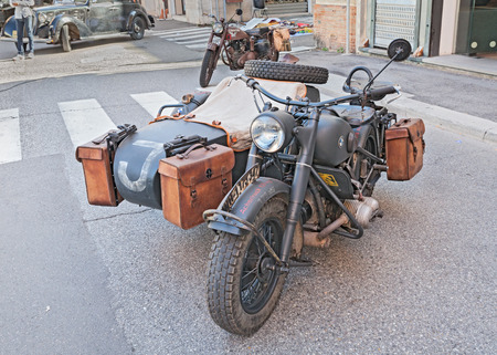 old BMW R75 750 cc, World War II-era German motorcycle with sidecar, at the military vehicle rally during the festival Fiera di San Rocco, on November 2, 2014 in Faenza, Italy