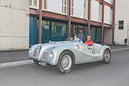 alfa: the crew Sthele - Mosel on a vintage racing car Alfa Romeo 6C 2500 SS (1947) in historic race for classic cars -Gran Premio Nuvolari- on September 21, 2014 in Lugo, RA, Italy Editorial