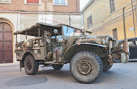 apt: FAENZA, ITALY - NOVEMBER 2: old offroad light truck Dodge D 34 APT WP Canada, World War II era, at the military vehicle rally during the festival Fiera di San Rocco on November 2, 2014 in Faenza, Italy Editorial