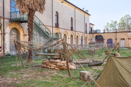 world war two: FAENZA, ITALY - NOVEMBER 2: reproduction of a defensive fighting position with cannon in camp of world war two, in the town feast Fiera di San Rocco on November 2, 2014 in Faenza, Italy Editorial