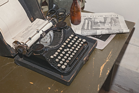 2 november: FAENZA, ITALY - NOVEMBER 2: old typewriter in reproduction of military camp office of world war 2 exposed during the town feast Fiera di San Rocco on November 2, 2014 in Faenza, Italy