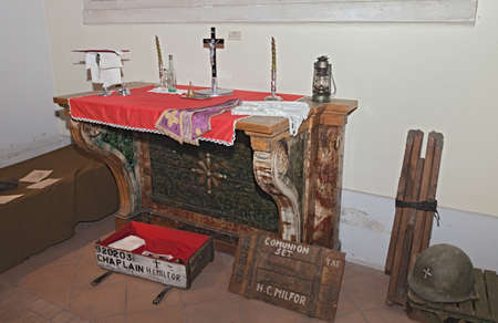 chaplain: FAENZA, ITALY - NOVEMBER 2: old catholic altar and American portable chaplain set of world war 2 exposed during the town feast Fiera di San Rocco on November 2, 2014 in Faenza, Italy