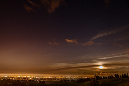 panoramic view at night from italian hills - city lights of Forli, Emilia Romagna, Italy photo