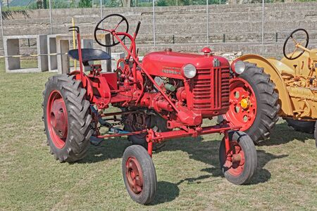traction engine: vintage asymmetric tractor Farmall Cub 10 cv (1955) exhibited during the festival -A tutta festa- on July 6, 2013 in Fognano, RA, Italy