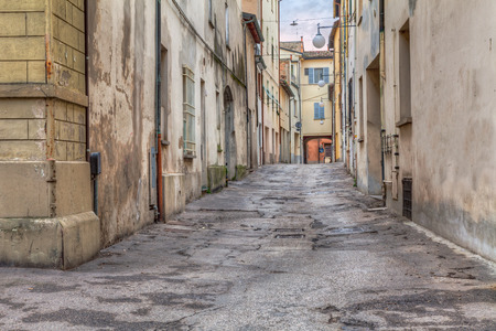 narrow dark alley in the old town - distressed alleyway in the italian city - urban decay, grunge aged street