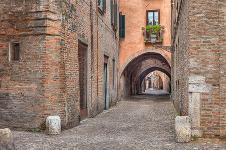volte: the picturesque alley Via delle Volte, ancient medieval street in Ferrara, Emilia Romagna, Italy Stock Photo
