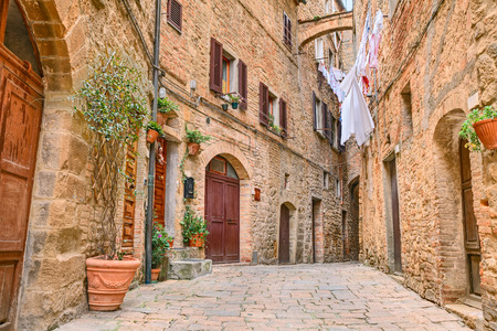 volterra: a picturesque typical corner with clothes hanging in the old town of Volterra, Tuscany, Italy