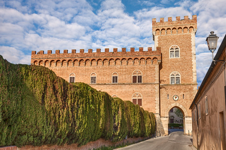 castle with tower and city gate of Bolgheri the village made famous by a poem by Carducci in Leghorn Tuscany Italy Editorial