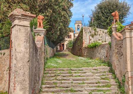 glimpse: path stairway in entrance to the catholic church of the country village Nugola near Leghorn in Tuscany Italy