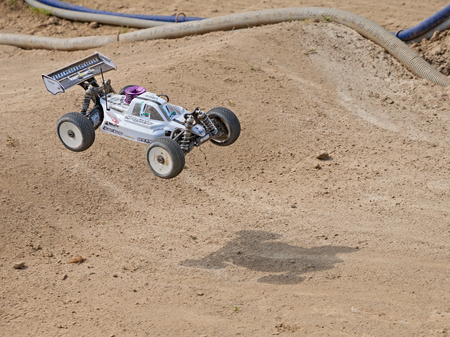 4wd: radio controlled buggy car model internal combustion engine scale 18 off road in dirt track Il Pozzo during the regional race AMSCI on April 26 2015 in Riolo Terme RA Italy