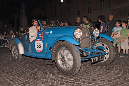 italian car: drivers on an old Italian car Bugatti T40 1927 traveling at night in italian historic race for classic cars Mille Miglia on May 14 2015 in Ravenna Italy
