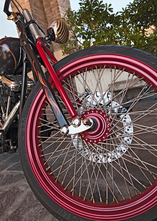 front wheel of a customized american motorbike Harley Davidson in motorcycle rally Mototagliatella on May 10 2015 in Predappio Italy