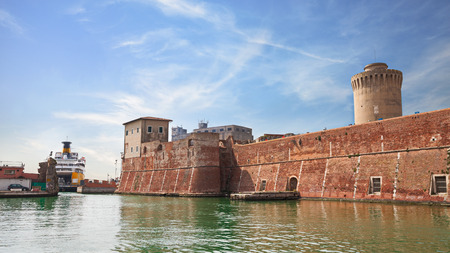 leghorn: Old fortress in the port of Leghorn  ancient castle in the harbor and ferry boat terminal in Livorno Tuscany Italy Editorial