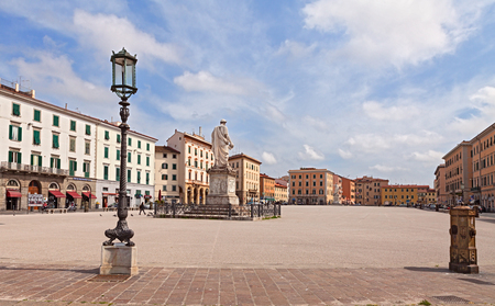 leghorn: Piazza della Repubblica a large square in the center town with two statues street lamps marble benches and small columns to tie the horses on April 15 2015 in Livorno Italy