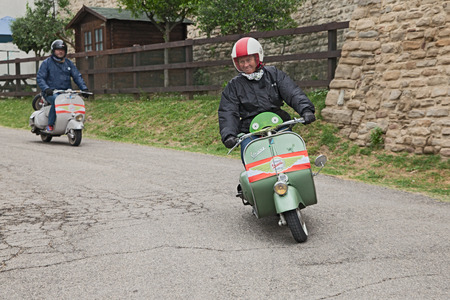fifties: Austrian biker riding a vintage italian scooter Vespa Piaggio in rally of classic Vespa of the forties - fifties Trofeo dellappennino on May 16, 2015 in Teodorano, FC, Italy