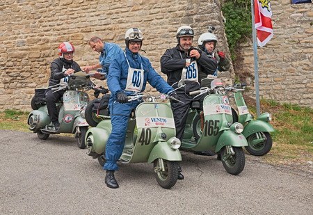 forties: bikers at the time control riding a vintage italian scooters in rally of classic Vespa of the forties - fifties Trofeo dellappennino on May 16, 2015 in Teodorano, FC, Italy