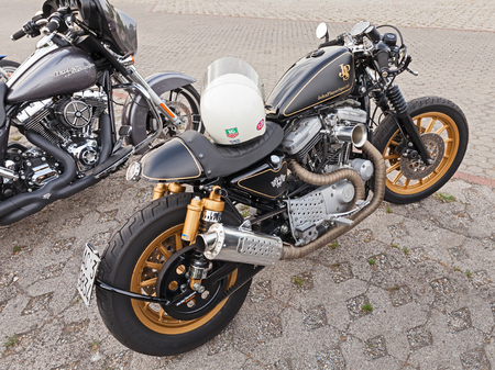 custom car: custom motorbike Harley Davidson Sportster cafe racer in rally of American vintage and custom car and motorcycle Kustom Revolution on June 15, 2015 in Forlimpopoli, FC, Italy