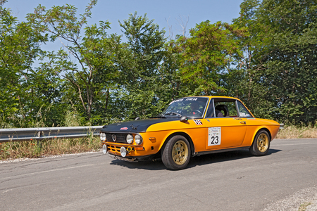 hf: driver and co-driver on a vintage Lancia Fulvia Montecarlo 1973 in classic car rally Coppa citt di Meldola on May 31, 2015 in Meldola FC Italy
