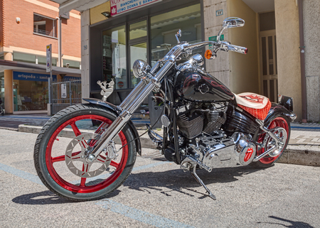 mockery: black and chrome custom American bike in Harley Davidson motorcycle rally on May 1, 2015 in Bellaria, Rimini, Italy