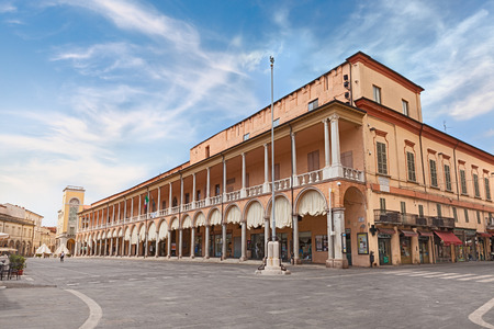 характеристика: Piazza del Popolo Peoples Square with characteristic double porch and curtains on the facade of the town hall. Photo taken on July 26, 2015 in the town of ceramics Faenza, Emilia Romagna, Italy