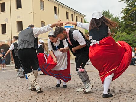 folk dance: the folk dance ensemble Irizema from Bova Marina, Calabria, Italy, performs traditional dance tarantella in the town square during the International Folklore Festival, on August 2, 2015 in Russi, Ravenna, Italy