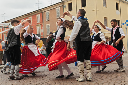 vaulting: the folk dance ensemble Irizema from Bova Marina, Calabria, Italy, performs traditional dance tarantella in the town square during the International Folklore Festival, on August 2, 2015 in Russi, Ravenna, Italy