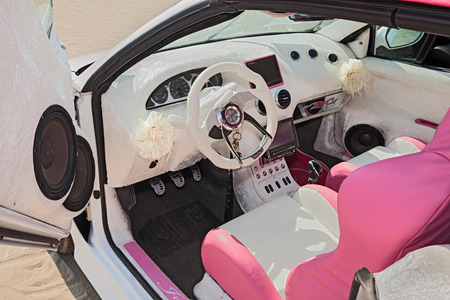 tuning: white and pink interior and dashboard of a tuning car exhibited at tuning car rally Cesenatico tuning day on July 12, 2015 in Cesenatico, Italy
