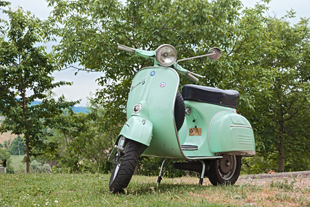 vespa: vintage italian scooter Vespa 125 GTR 1969 parked during the rally of classic Vespa Trofeo dellappennino on May 16, 2015 in Teodorano, FC, Italy