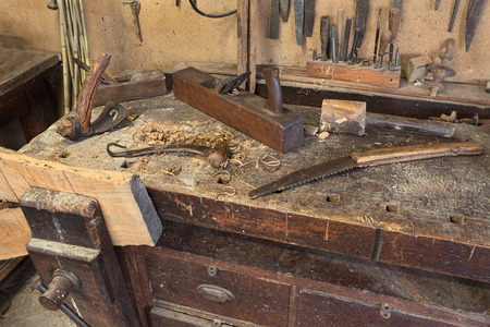 carpenter's bench: woodworking tools of antique carpentry - old bench with carpenters equipment  - ancient carpentry craftsman workshop