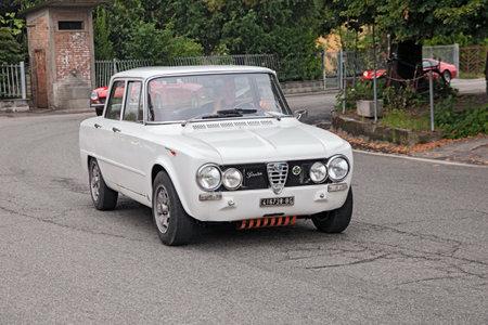 italian car: driver on a vintage italian car Alfa Romeo Giulia in rally Raduno auto e moto depoca di Villafranca on July 27, 2014 in Forli, Italy Editorial