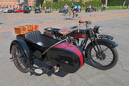 rarity: old sidecar motorbike NSU 501 T 1927 parked during the classic car, motorcycle and bicycle rally, on August 30, 2015 in Lugo, Ravenna, Italy