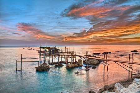 stilt house: old fishing hut trabocco, the typical wooden palafitte in the sunrise of the Mediterranean sea coast in Chieti, Abruzzo, Italy