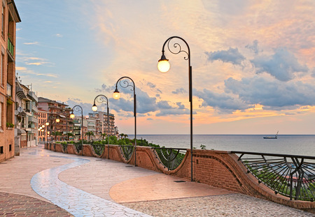 seafront at dawn in Ortona, Abruzzo, Italy - beautiful terrace with street lamp on the Adriatic sea