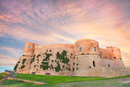 the old castle Castello Aragonese overlooking the sea at sunset in Ortona, Abruzzo, Italy