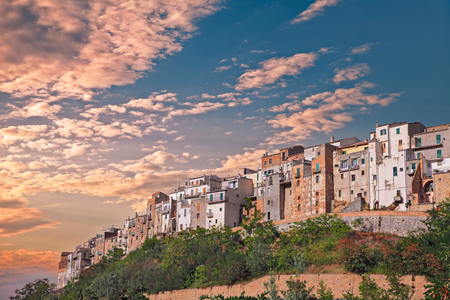 landscape at sunset under a dramatic cloudy sky of the italian old town on the hill Atessa, Abruzzo, Italy