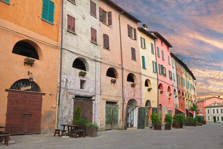 ravenna: street with picturesque ancient palace with colored wall in the old town of Brisighella, Ravenna, Italy