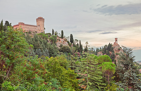 emilia romagna: landscape of Emilia Romagna hills with medieval castle and clock tower in the green of the ancient town Brisighella, Ravenna, Italy Editorial
