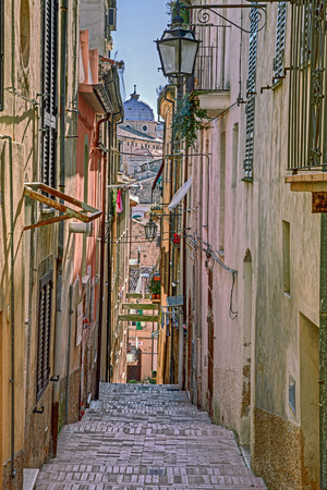 abruzzo: picturesque old narrow alley with stairway and cathedral on background in the ancient town Lanciano, Abruzzo, Italy Stock Photo