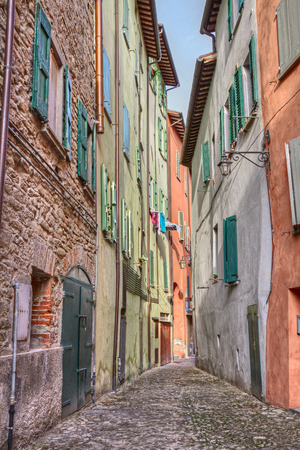 emilia romagna: picturesque old narrow alley with colored walls in the ancient town Brisighella, Emilia Romagna, Italy