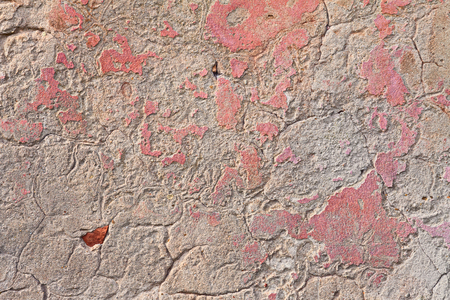parget: old wall with scratched plaster and remains of pink paint - grunge background texture